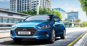 elantra-gallery-front-view-driving-blue-elantra-road-city-original