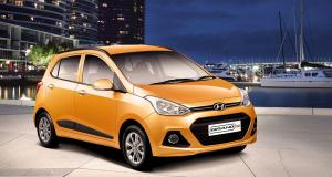 grand-i10-gallery-side-front-orange-lakeside-night-original