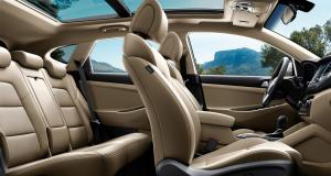 tuscon-gallery-beige-interior-front-seats-passenger-viewpoint-original