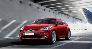 veloster-gallery-left-front-red-veloster-driving-road-original