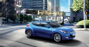 veloster-gallery-right-front-blue-veloster-driving-road-city-original